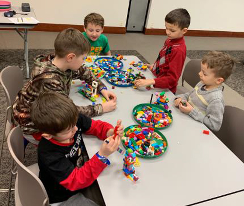photo of kids building lego structure